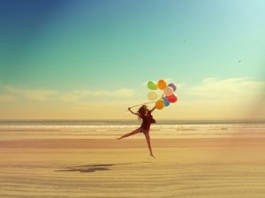 carefree woman with balloons