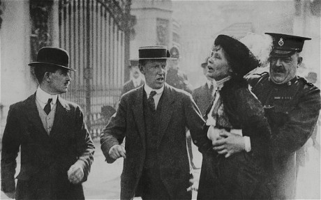 emmeline pankhurst being carrie doff by a policeman